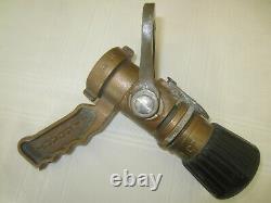 Antique brass fire hose nozzle