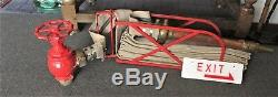 Fire Hose In Wall Mounted Cradel With Fire Nozzle & Hand Operated Tap C 1950's