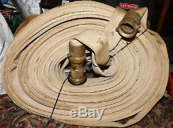 Old Vintage Antique Fire Hose with Nozzle Firefighter